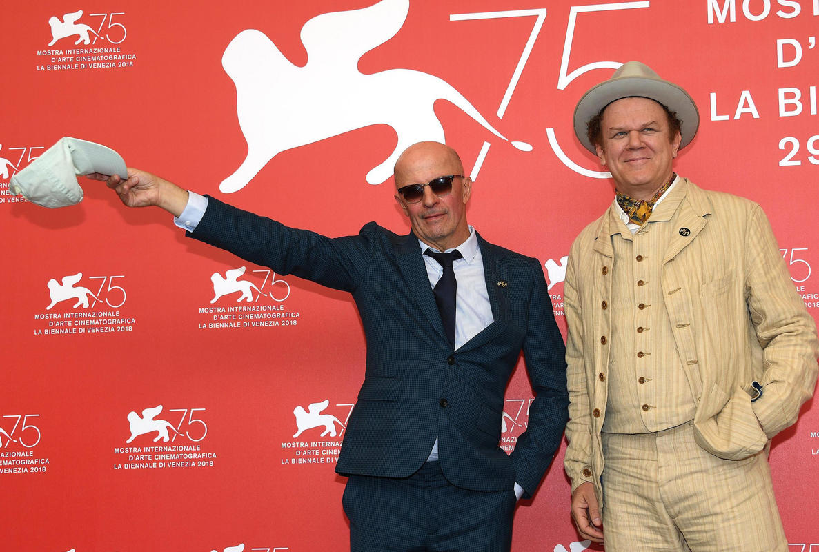 Jacques Audiard and John C. Riley
